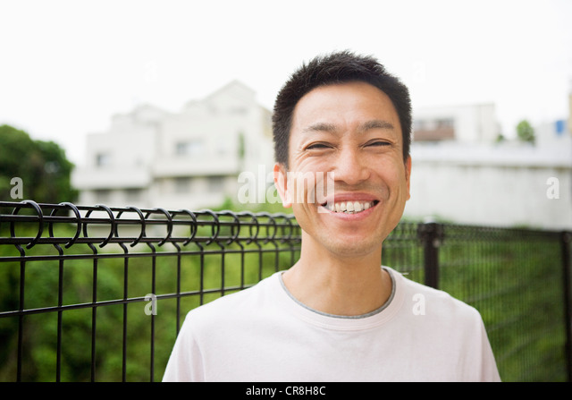 Portrait of a happy man outdoors - Stock Image