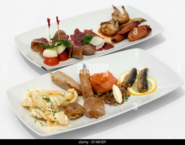 Entree tasting plates containing an assortment of seafood and meats - Stock Image