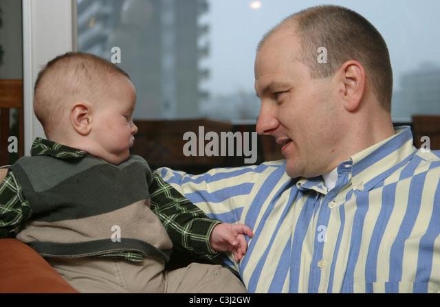 Dad talking with baby boy - Stock-Bilder