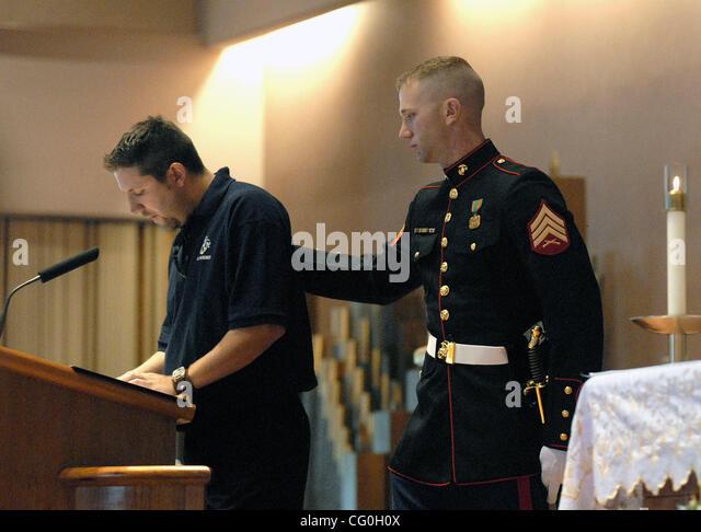 Giving a speech at a funeral