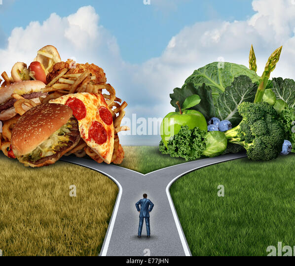 Diet decision concept and nutrition choices dilemma between healthy good fresh fruit and vegetables or greasy cholesterol - Stock Image
