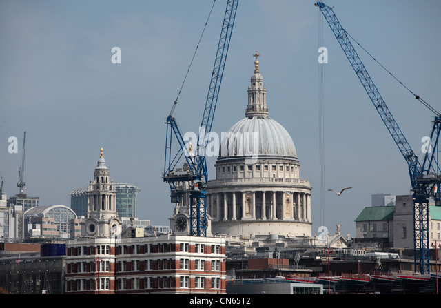 Construction work in London Town with St Paul's Cathedral in the background near the River Thames - Stock Image
