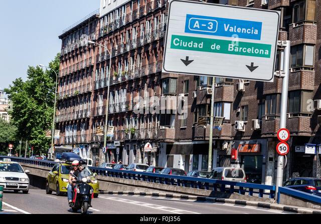 Spain Europe Spanish Madrid Centro Lavapias Ronda de Atocha traffic apartment building - Stock Image