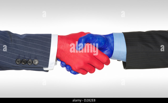 Handshake between two males.  Handshake denotes creative concept of republican and democratic political parties - Stock Image