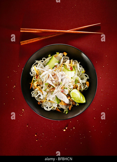 Spicy chicken noodles, an Asian style dish - Stock-Bilder