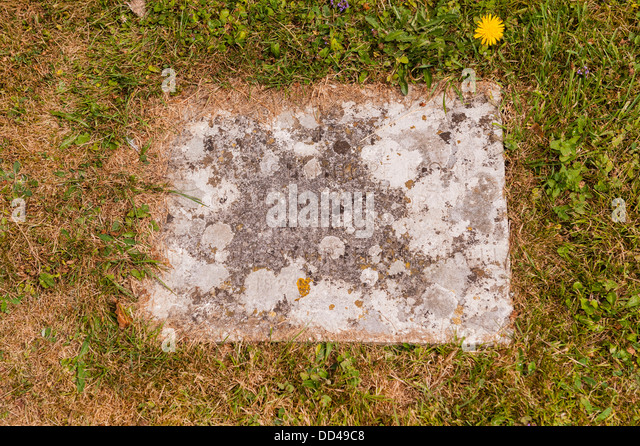 A corroded grave stone - Stock Image