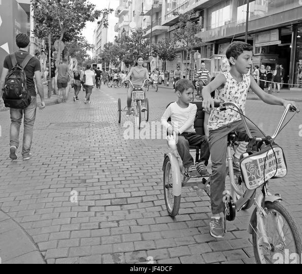 Lebanese take to Hamra Street in Beirut, Lebanon for biking day when scars are banned during hours. - Stock Image
