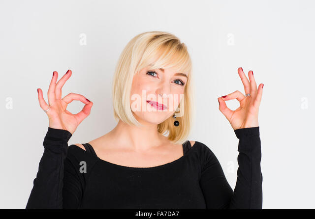 Positivity and success: A young slim blonde blond haired woman girl, looking assured and confident, healthy, holding - Stock Image