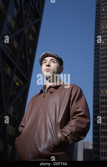 Portrait of a young man in an urban setting at dusk, San Francisco, California, USA - Stock Image