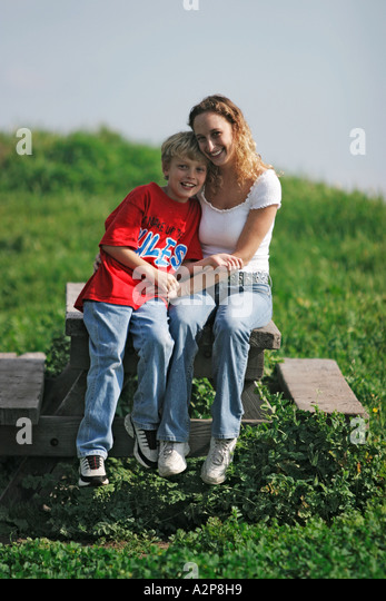 A young mother with her child at the park. - Stock Image