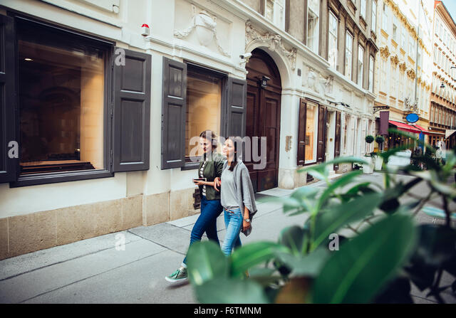Austria, Vienna, two female friends exploring the old town - Stock Image
