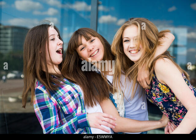 Portrait of three young women in a row - Stock Image