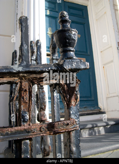 Heavily corroded Regency era wrought iron railings outside Regency house in Laura Place Aberystwyth Ceredigion Wales - Stock Image