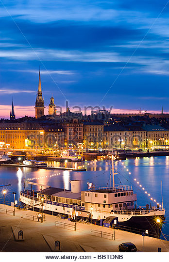 Gamla Stan, the old town of Stockholm, at night, from Katarinavägen, Sweden. - Stock Image