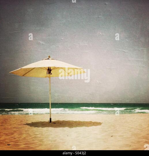 An umbrella on the beach. Abu Dhabi. United Arab Emirates. - Stock Image