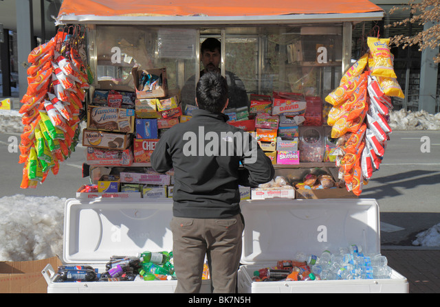 Washington DC 9th Street NW street vendor cart business snack food soft drink soda cooler can package chips candy - Stock Image
