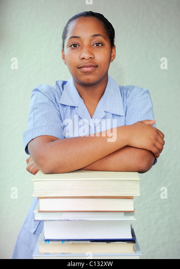 School girl with a pile of books, Cape Town, South Africa - Stock Image