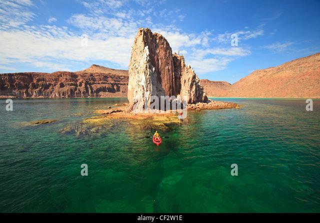 A Tourist Rows In A Boat In Los Islotes National Marine Park Off Espiritu Santo Island; La Paz Baja California Sur - Stock Image