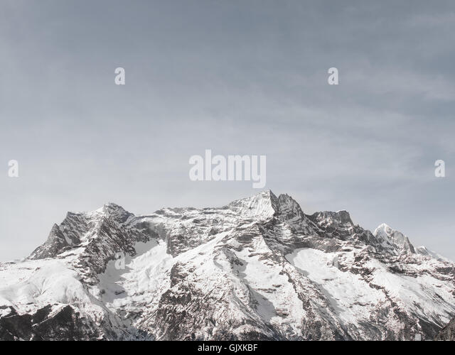 Snow covered mountains in Nepal's Everest Base Camp - Stock Image