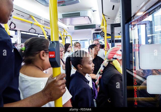 South Africa African Cape Town City Centre Civic Centre Station MyCiTi bus coach passengers Black woman - Stock Image