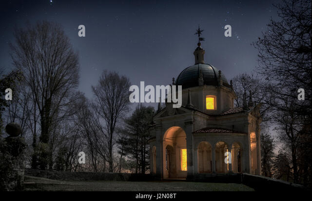 A chapel in the winter night with blue sky in the background, Sacred Mount of Varese - Lombardy, Italy - Stock Image