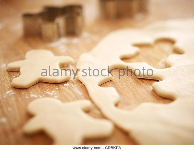 Gingerbread men cookie dough - Stock-Bilder