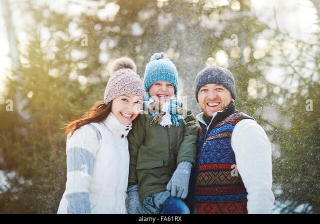 Ecstatic family enjoying time in winter park - Stock Image