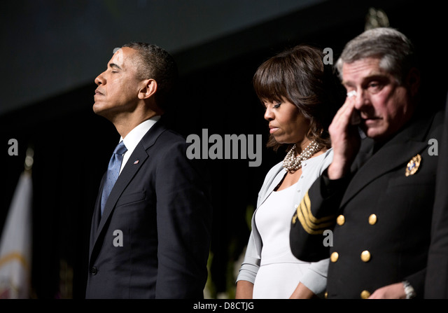 US President Barack Obama and First Lady Michelle Obama pause during a memorial service for victims of a fertilizer - Stock Image