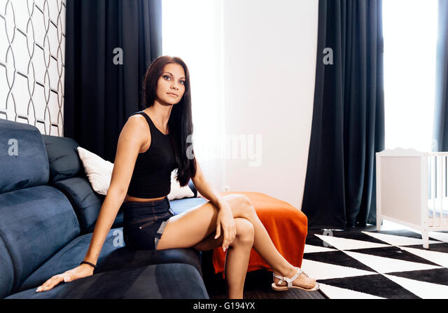 Beautiful young woman in a hotel room - Stock Image
