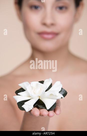 Woman offering flower - Stock-Bilder