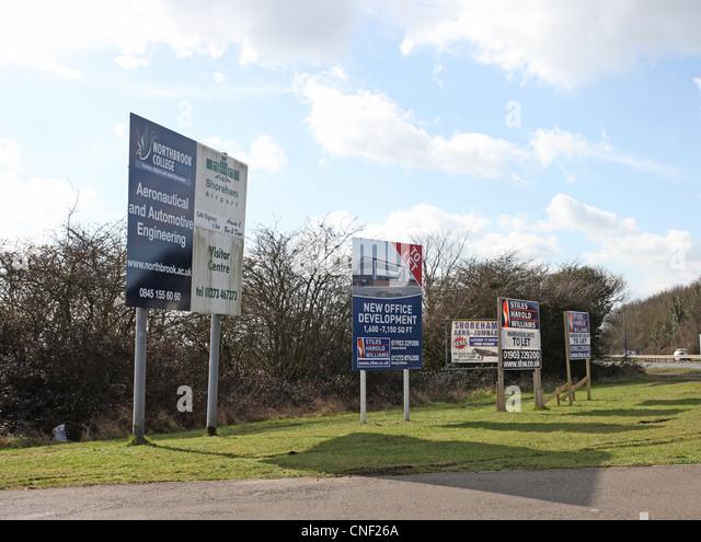 Five roadside advertising signs near Shoreham Airport - Stock Image
