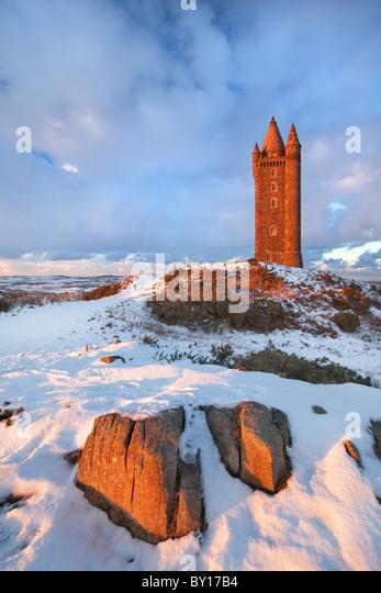 Scrabo Tower under snow fall, Newtownards - Northern Ireland. - Stock Image