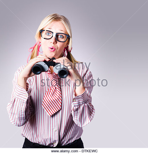 Smart business development manager planning future strategy while looking to the distant horizon with binoculars - Stock Image