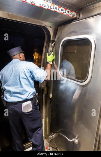 Washington DC District of Columbia Union Station railroad train Amtrak Black man crew stop open door interior inside - Stock Image