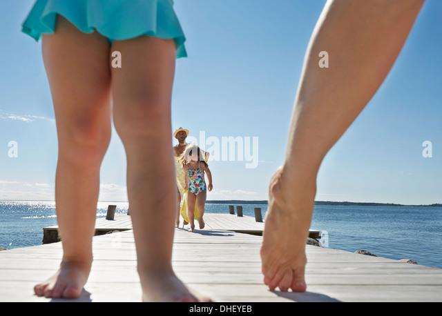 Close up of family walking on pier, Utvalnas, Gavle, Sweden - Stock-Bilder