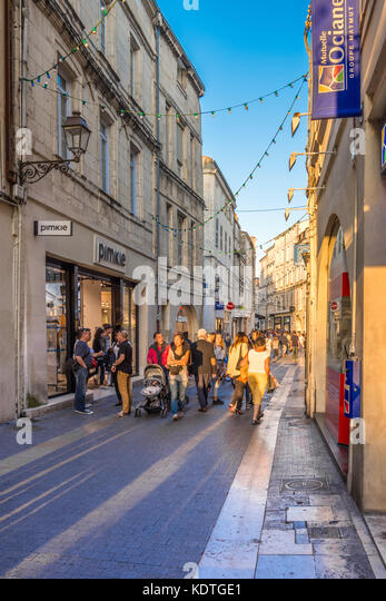 Shoppers in narrow street of the old town, La Rochelle, France. - Stock Image