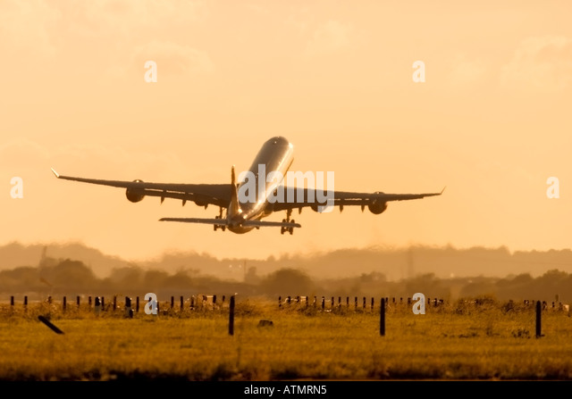 Commercial airplane taking off - Stock Image