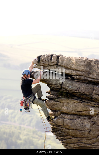 Rock climbing on Bamford Edge Peak District National Park Derbyshire Peak District National Park - Stock Image