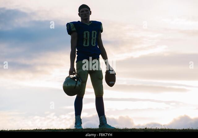 Portrait of young american football player - Stock Image