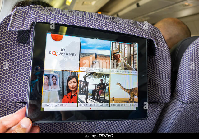 Australia Victoria Melbourne Tullamarine Airport MEL Qantas Airlines onboard airliner commercial seat iPad inflight - Stock Image
