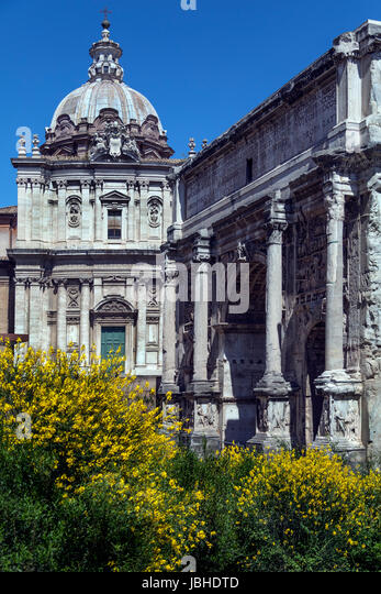 The Roman Forum - Rome Italy. The Arch of Septimius Severus and the church of Santi Luca-e-Martina. The arch is - Stock Image