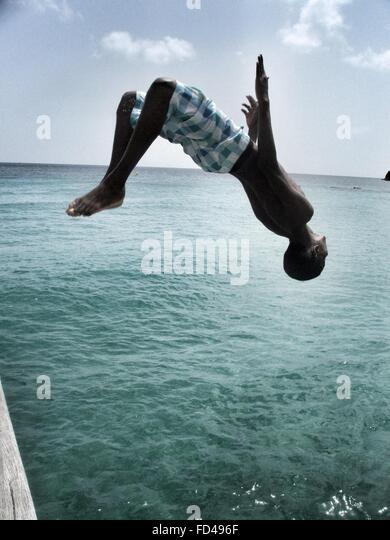 Man Diving In Sea - Stock Image