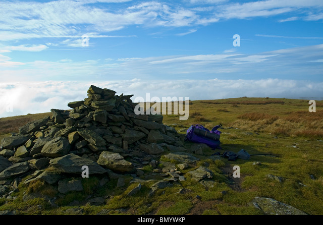 Mist and low cloud from the summit cairn of Cadair Berwyn, Berwyn Hills, Snowdonia, North Wales, UK - Stock Image