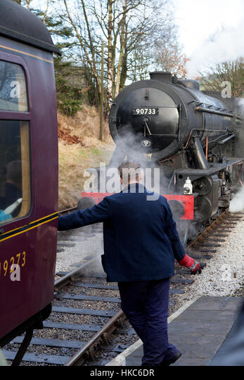 Steam locomotive 90733 approaching train for coupling, Oxenhope, West Yorkshire - Stock Image