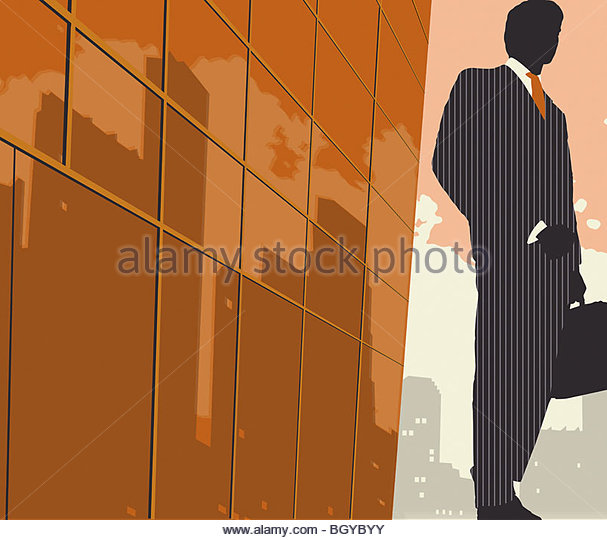 Businessman on sidewalk with briefcase - Stock Image