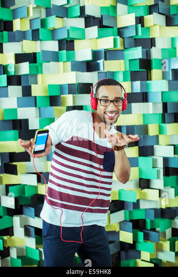 Man dancing to mp3 player - Stock Image