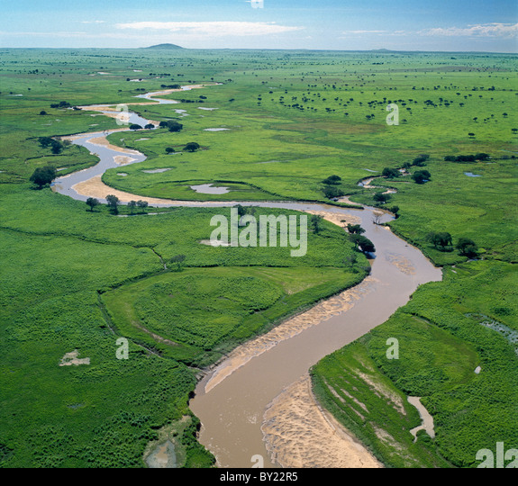 The Garamba River winds it way through the grasslands of the Garamba National Park in Northern Congo DRC. - Stock-Bilder