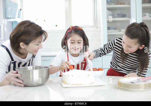 Family making sweets - Stock Image