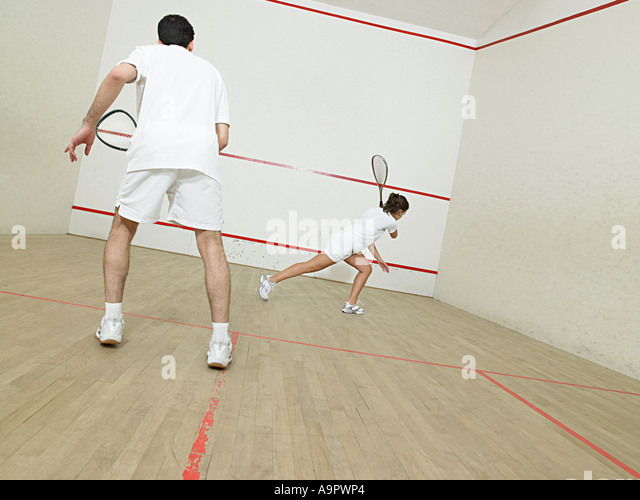 Man and woman playing squash - Stock Image