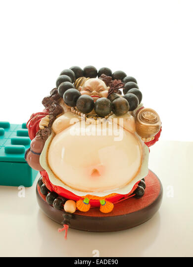 Confucius jewelry stand with bead bracelet - Stock Image